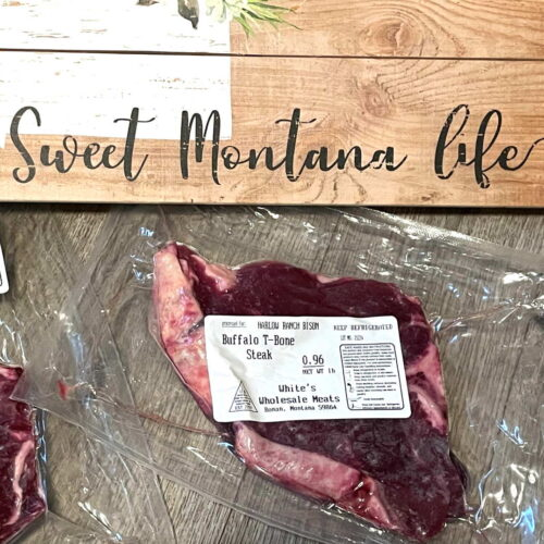 Sweet Montana Life board with bison steaks in front